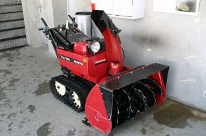 Heavy-duty walk-behind 2-stage snow blower.