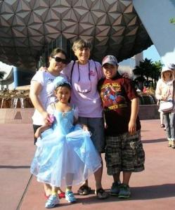 Mary with her daughter and two grandchildren at Disney World