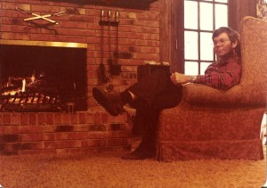 Happy days - my husband, Don, by the fire at our house.