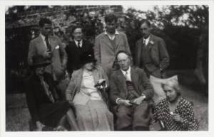 The Bloomsbury Group in the garden at Charleston, Vanessa Bell and Duncan Grant's home, in 1930. Standing from left to right: Angus Davidson, Duncan Grant, Julian Bell and Leonard Woolf. Seated: Virginia Woolf, Margaret Duckworth, and Clive and Vanessa Bell. From the Tate Archive.